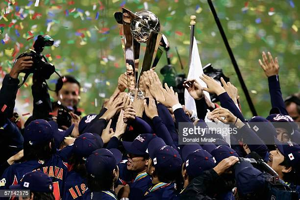 Members of Team Japan celebrate with the World Baseball Classic Trophy after defeating Team Cuba in the Final game of the World Baseball Classic at...