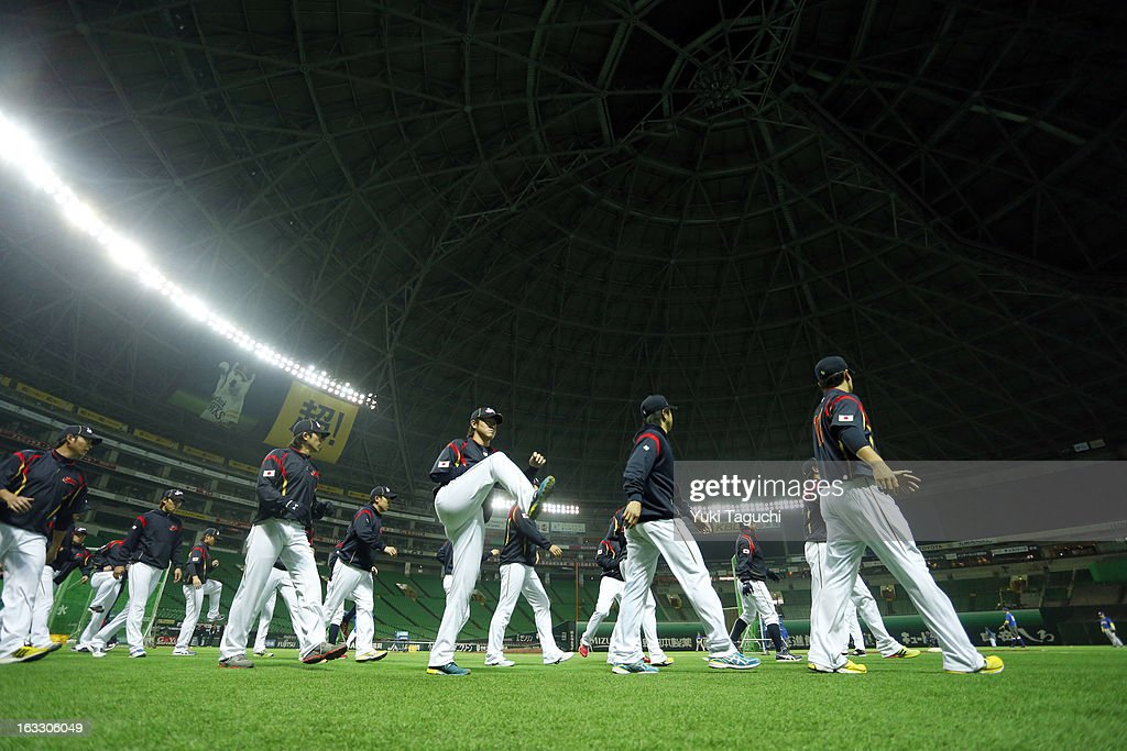 Members of Team Japan stretch during the World Baseball Classic workout day at the Yahoo Dome on February 27, 2013 in Fukuoka, Japan.