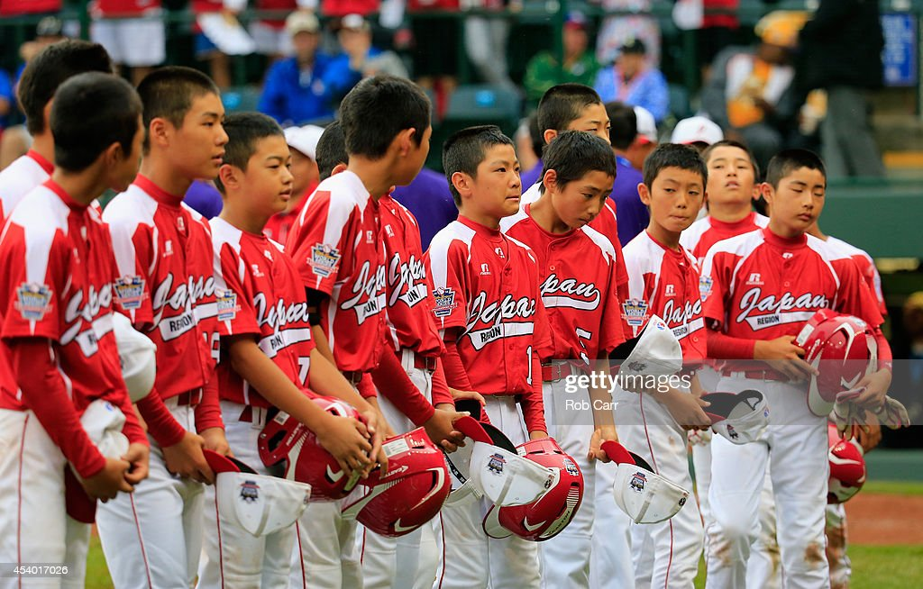 Members of Team Japan wait to shake hands with Team Asia-Pacific following their 12-3 loss during the International Championship game of the Little League World Series at Lamade Stadium on August 23, 2014 in South Williamsport, Pennsylvania.