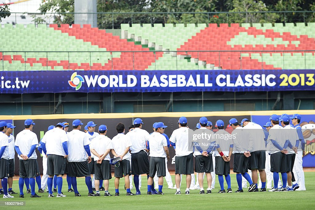 Members of Team Korea meet in the outfield during the World Baseball Classic workout day at Taichung Intercontinental Baseball Stadium on Friday, March 1, 2013 in Taichung, Taiwan.