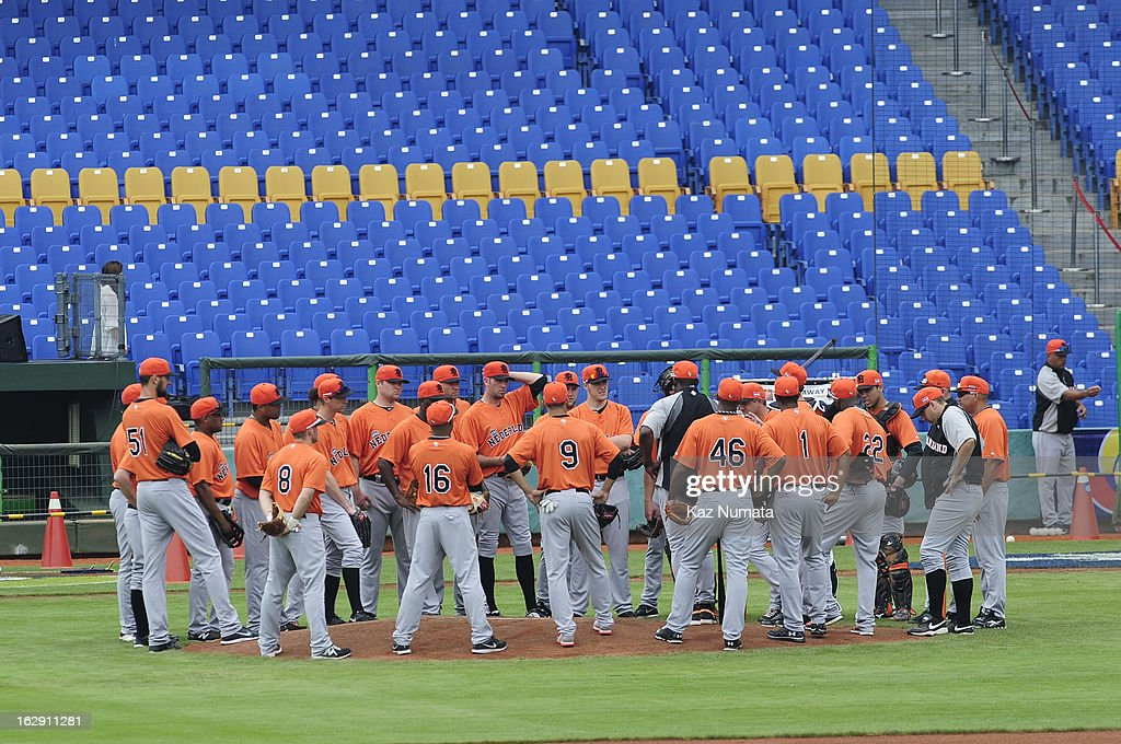 Members of Team Netherlands meet on the mound during the World Baseball Classic workout day at Taichung Intercontinental Baseball Stadium on March 1, 2013 in Taichung, Taiwan.