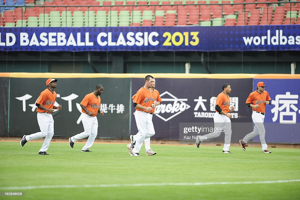 Members of Team Netherlands warm up in the outfield before the World Baseball Classic exhibition game against the Industrial All-Star Team at Intercontinental Stadium on Tuesday, February 26, 2013 in Taichung, Tawain.