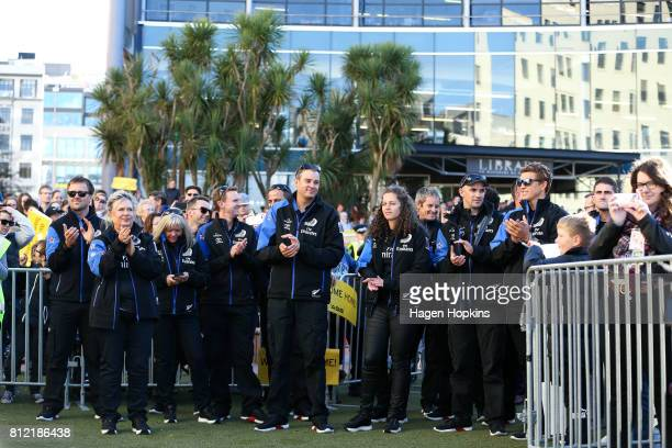 Members of Team New Zealand look on during the Team New Zealand Americas Cup Wellington Welcome Home Parade on July 11 2017 in Wellington New Zealand