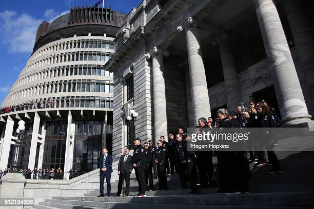 Members of Team New Zealand stand on the steps of Parliament during the Team New Zealand Americas Cup Wellington Welcome Home Parade on July 11 2017...