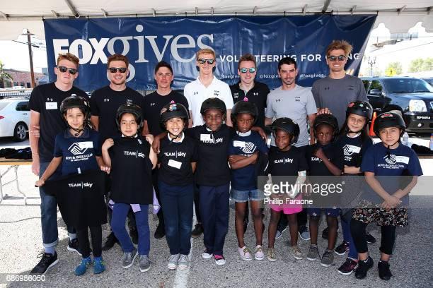 Members of Team Sky Tao Geoghegan Hart Owain Doull Pete Kennaugh Ian Boswell Elia Viviani David Lopez and Jonathan Dibben met with kids from the Boys...
