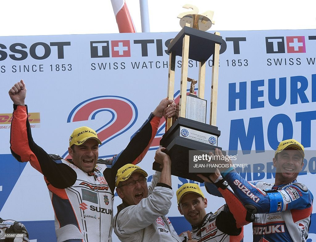Members of team Suzuki N°1 France's Erwan Nigon France's team manager Dominique Meliand France's Anthony Delhalle France's Vincent Philippe celebrate...