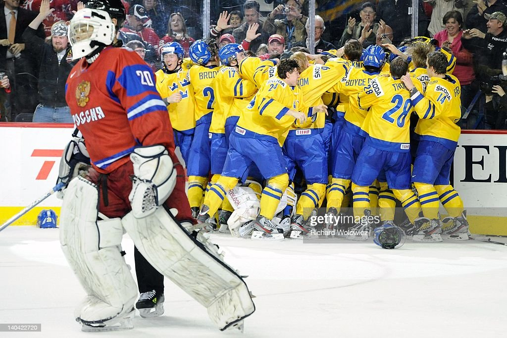 Members of Team Sweden celebrate after defeating Team Russia during the 2012 World Junior Hockey Championship Gold Medal game at the Scotiabank Saddledome on January 5, 2012 in Calgary, Alberta, Canada. Team Sweden defeated Team Russia 1-0 in overtime.