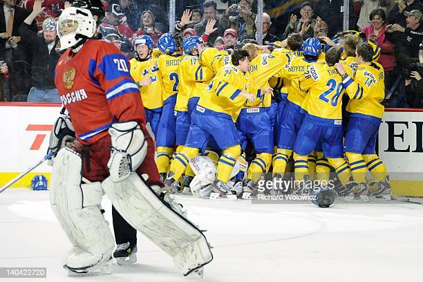 Members of Team Sweden celebrate after defeating Team Russia during the 2012 World Junior Hockey Championship Gold Medal game at the Scotiabank...