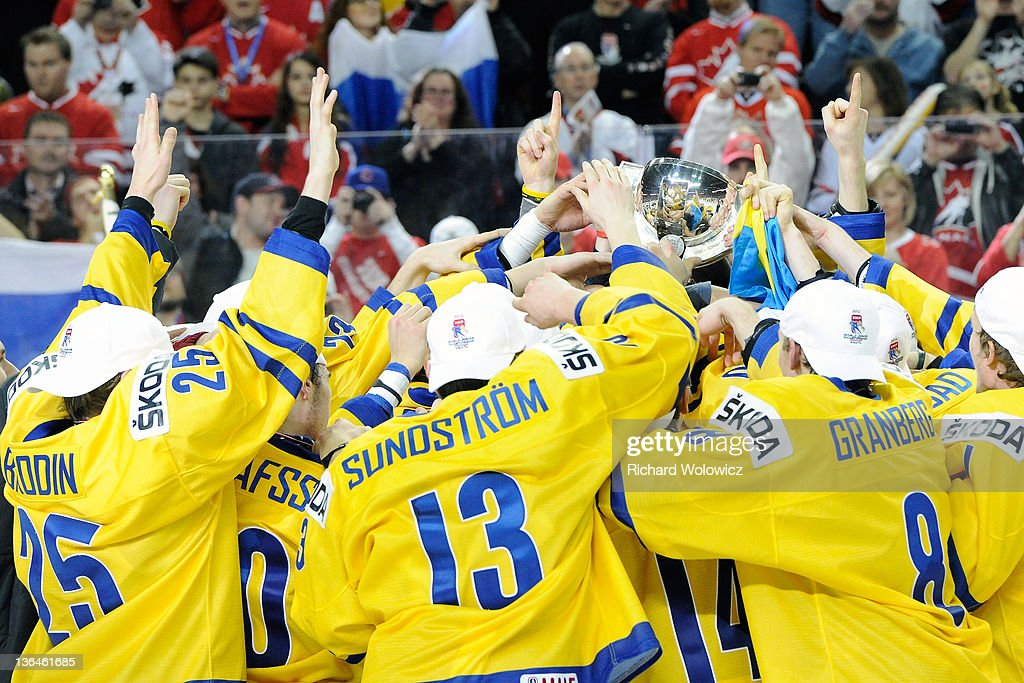 Members of Team Sweden celebrate after defeating Team Russia in the 2012 World Junior Hockey Championship Gold Medal game at the Scotiabank Saddledome on January 5, 2012 in Calgary, Alberta, Canada. Team Sweden defeated Team Russia 1-0 in overtime.