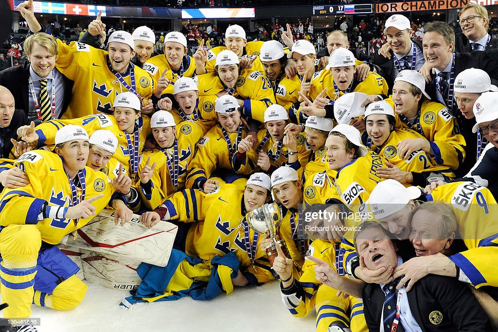 Members of Team Sweden pose for a team photo after defeating Team Russia in the 2012 World Junior Hockey Championship Gold Medal game at the Scotiabank Saddledome on January 5, 2012 in Calgary, Alberta, Canada. Team Sweden defeated Team Russia 1-0 in overtime.