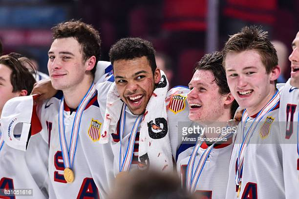 Members of Team United States lock arms after defeating Team Canada during the 2017 IIHF World Junior Championship gold medal game at the Bell Centre...