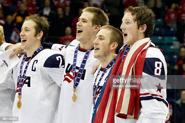 Members of Team USA sing the national anthem after defeating Team Canada at the 2010 IIHF World Junior Championship Tournament Gold Medal game on...