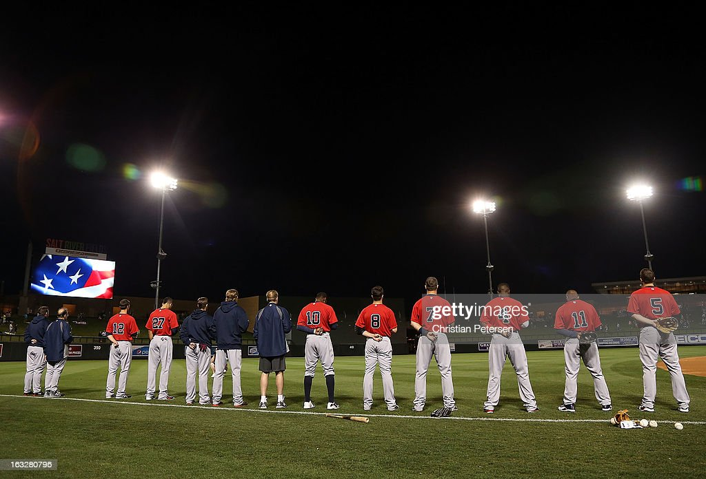 Members of Team USA stands attended for the National Anthem before the spring training game against the Colorado Rockies at Salt River Fields at Talking Stick on March 6, 2013 in Scottsdale, Arizona.