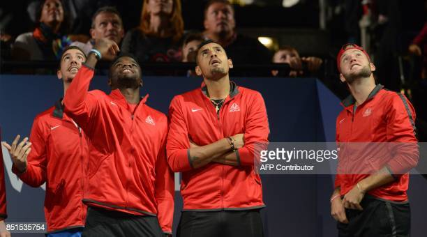 Members of Team World react during the match between Austrian Dominic Thiem and John Isner of United States and Team World during the first day of...