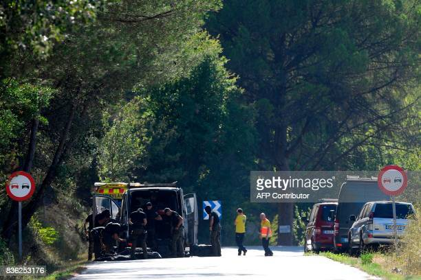 TOPSHOT Members of TEDAXNRBQ on the site where Moroccan suspect Younes Abouyaaqoub was shot on August 21 2017 near Sant Sadurni d'Anoia south of...