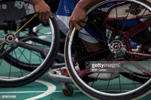Members of Thailand's national wheelchair basketball team bump up against each other during training at a government sports facility in Cholburi...