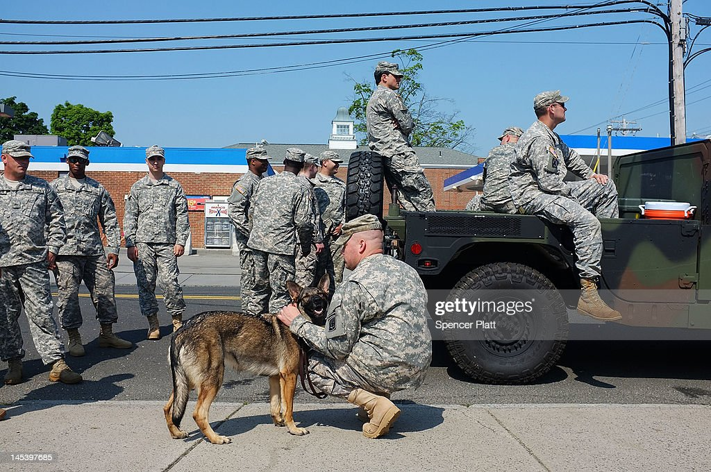Members of the 102nd Infantry National Guard from Norwalk, CT participate in the annual Memorial Day Parade on May 28, 2012 in Fairfield, Connecticut. Across America towns and cities will be celebrating veterans of the United States Armed Forces and the sacrifices they have made. Memorial Day is a federal holiday in America and has been celebrated since the end of the Civil War.