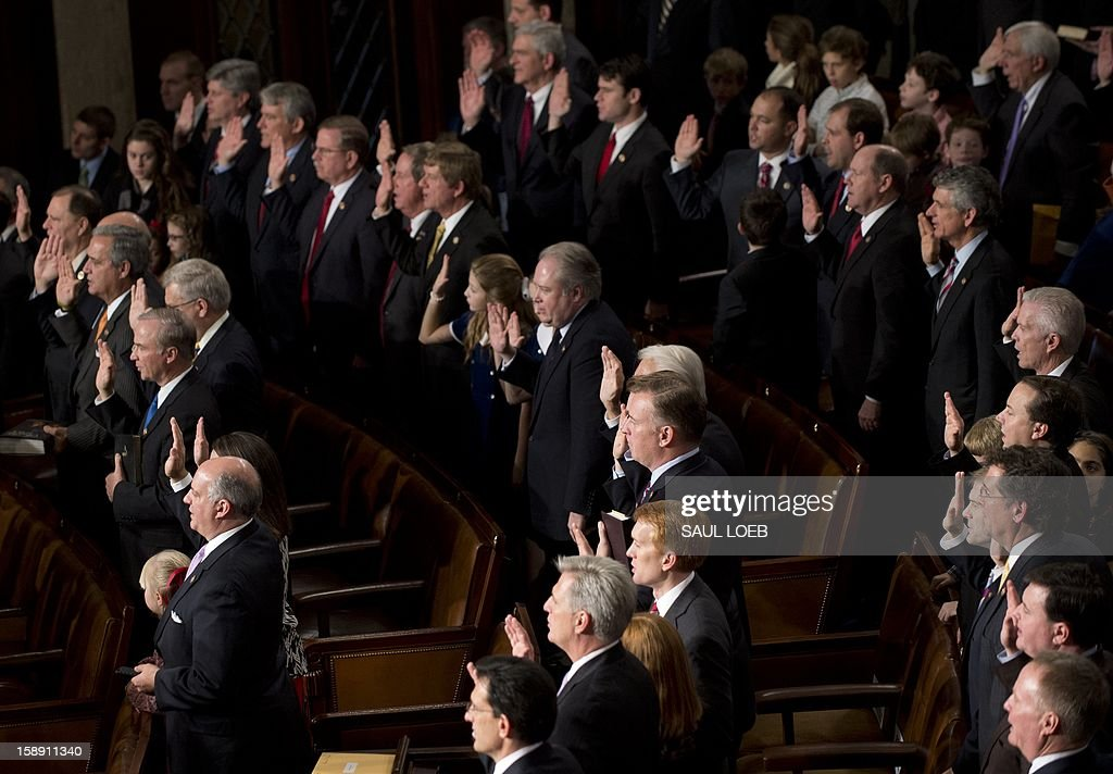 Members of the 113th US House of Representatives take their oath as they are sworn in during the opening session at the US Capitol in Washington, DC, on January 3, 2013. AFP PHOTO / Saul LOEB