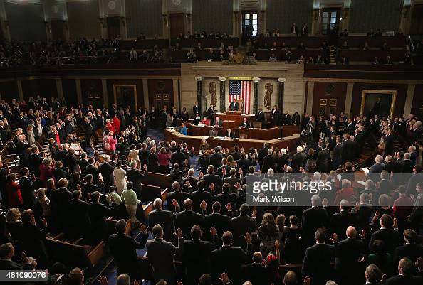 Members of the 114th Congress raise their right hand as they are sworn in at the US Capitol January 6 2015 in Washington DC Today Congress convened...