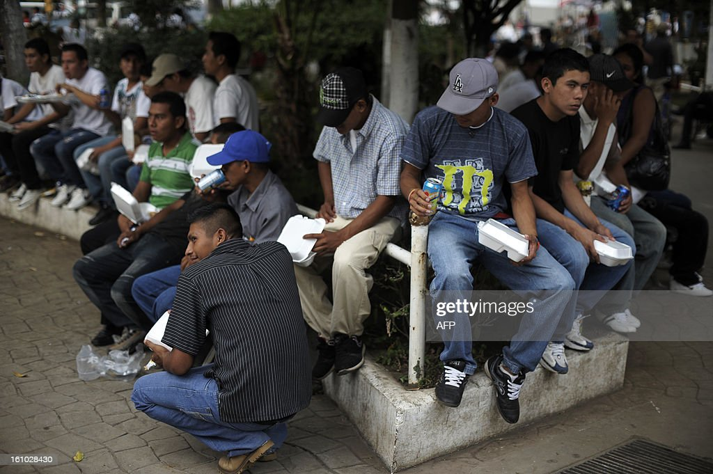 Members of the MS-13 gang gather at the central park of the city of Sonsonate, 65 Km west of San Salvador, on February 8, 2012. Leaders of the MS-13 and 18th Street gangs agreed to stop homicides in the city of Sonsonate, as part of the truce process between gangs to reduce crimes in El Salvador. AFP PHOTO/Jose CABEZAS