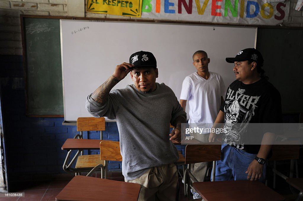 Members of the MS-13 gang participate in a press conference at the Sonsonate Central Jail in the city of Sonsonate, 65 Km west of San Salvador, on February 8, 2012. Leaders of the MS-13 and 18th Street gangs agreed to stop homicides in the city of Sonsonate, as part of the truce process between gangs to reduce crimes in El Salvador. AFP PHOTO/Jose CABEZAS