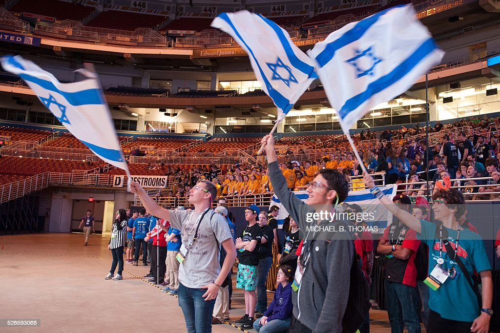 Members of the 1339 BumbleB team from Israel celebrate during the FIRST Robotics Championships on April 30, 2016 in St. Louis, Missouri. Six hundred teams representing 10 countries compete over three days. / AFP / Michael B. Thomas
