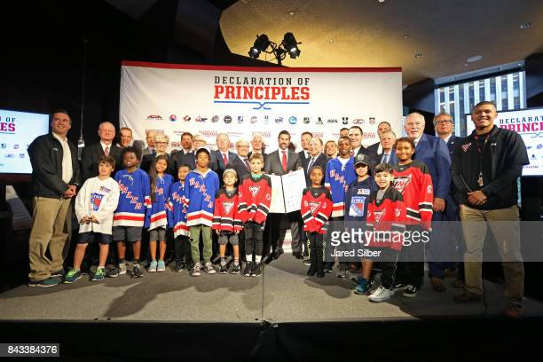 Members of the 17 leading hockey organizations and select youth hockey players join NHL Commissioner Gary Bettman for a posed photo with the signed...