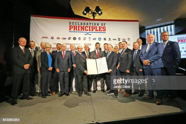 Members of the 17 leading hockey organizations join NHL Commissioner Gary Bettman for a posed photo with the signed Declaration of Principles during...