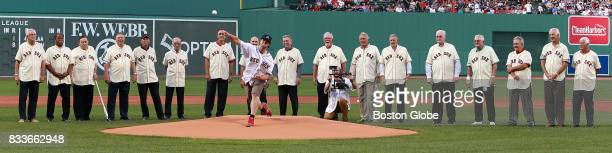 Members of the 1967 'Impossible Dream' Red Sox team are honored before the start of the game as former DanaFarber patient Jordan Leandre fires the...