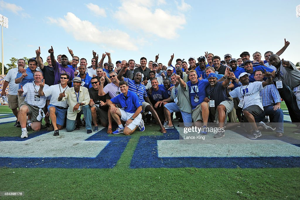 Members of the 1989 Duke football team pose for a photo during a game between the Elon Phoenix and the Duke Blue Devils at Wallace Wade Stadium on August 30, 2014 in Durham, North Carolina. The 1989 Duke football team was honored for their 8-4 record and winning a share of the ACC title.