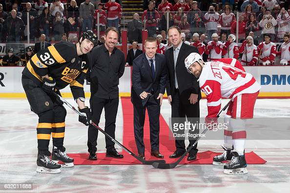 Members of the 19971998 Detroit Red Wing Grind Line Joey Kocur Kris Draper and Kirk Maltby ceremoniously drop the puck between captains Zdeno Chara...