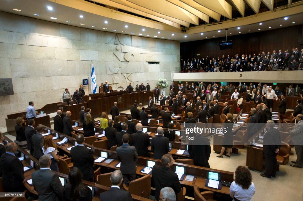 Members of the 19th Knesset, the new Israeli parliament, stand as President <a gi-track='captionPersonalityLinkClicked' href=/galleries/search?phrase=Shimon+Peres&family=editorial&specificpeople=201775 ng-click='$event.stopPropagation()'>Shimon Peres</a> arrives to the swearing-in ceremony of the 19th Knesset, the new Israeli parliament on February 5, 2013 in Jerusalem, Israel. President Peres welcomed 120 new and returning MKs.