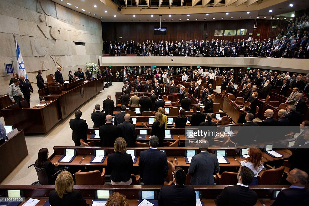 Members of the 19th Knesset, the new Israeli parliament, stand as President <a gi-track='captionPersonalityLinkClicked' href=/galleries/search?phrase=Shimon+Peres&family=editorial&specificpeople=201775 ng-click='$event.stopPropagation()'>Shimon Peres</a> arrives to their swearing-in ceremony at the parliament on February 5, 2013 in Jerusalem, Israel. The 120 members included a record 48 new law makers.
