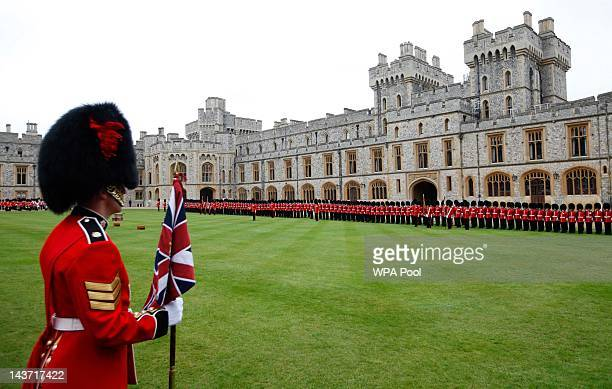 Members of the 1st Battalion and No 7 Company the Coldstream Guards line up for inspection before being presented with their new colours by Queen...
