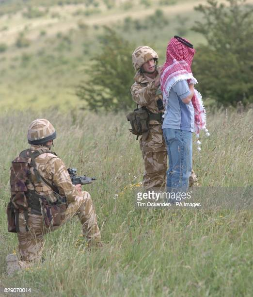 Members of the 1st Battalion The Black Watch train on stop and search during an exercise on Salisbury Plain before the Battallion's deployment to...