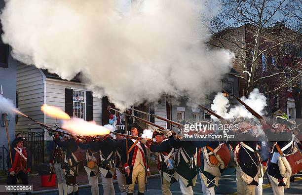 Members of the 1st Virginia Regiment of the Continental Line fire a volley during the George Washington Birthday Parade on Monday February 18 2013 in...