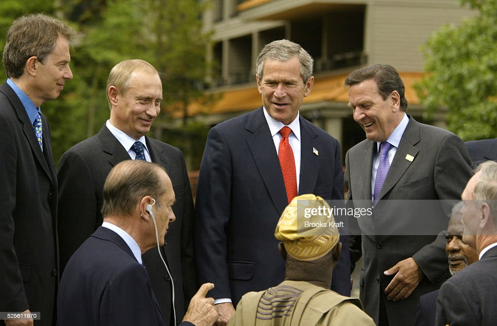 Members of the 2002 G8 economic summit chat with leaders of African nations at the meeting's conclusion in Alberta, Canada. (L-R): England's prime minister Tony Blair, Russian president Vladimir Putin, United States president George W. Bush, and German chancellor Gerhard Schroeder. Sitting with their backs to the camera are French president Jacques Chirac and Nigerian president Olusegun Obasanjo.