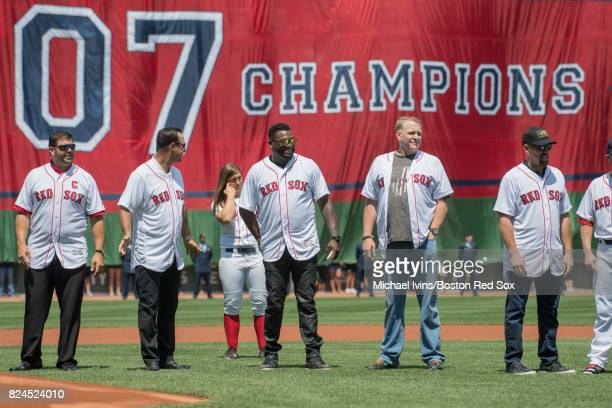 Members of the 2007 Boston Red Sox from left Jason Varitek Tim Wakefield David Ortiz Curt Schilling and Kevin Youkilis line up during a ceremony...