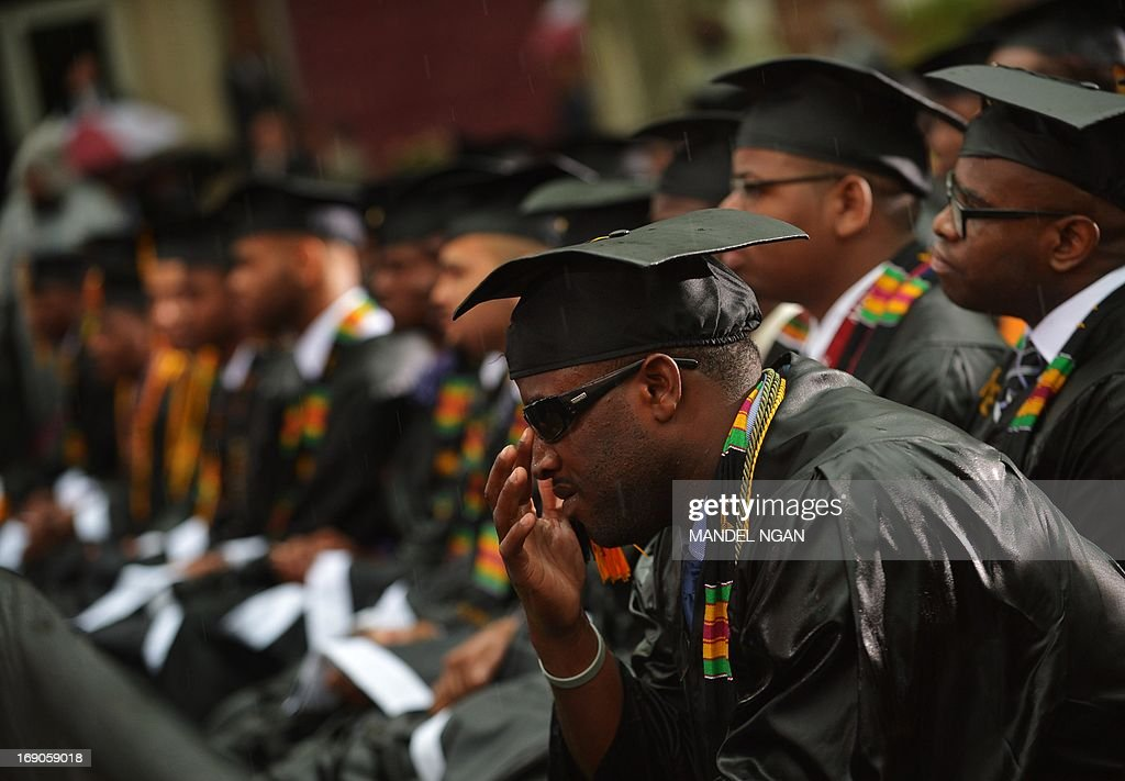 Members of the 2013 graduating class sit in the rain as they listens to US President Barack Obama deliver the commencement address during a ceremony at Morehouse College on May 19, 2013 in Atlanta, Georgia. AFP PHOTO/Mandel NGAN