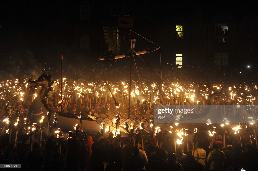Members of the 2013 'Jarl Squad' take part in the annual Up Helly Aa festival which culminates in the burning of a Viking Galley in Lerwick, Shetland Islands on January 29, 2013. Up Helly Aa celebrates the influence of the Scandinavian Vikings in the Shetland Islands and has employed this theme in the festival since 1870. The event culminates with up to 1,000 'guizers' (men in costume) throwing flaming torches into their Viking longboat. AFP PHOTO / ANDY BUCHANAN