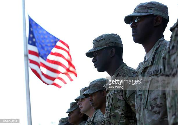 Members of the 273rd Military Police Company of DC Army National Guard stand at attention during a homecoming ceremony October 16 2012 at the DC...
