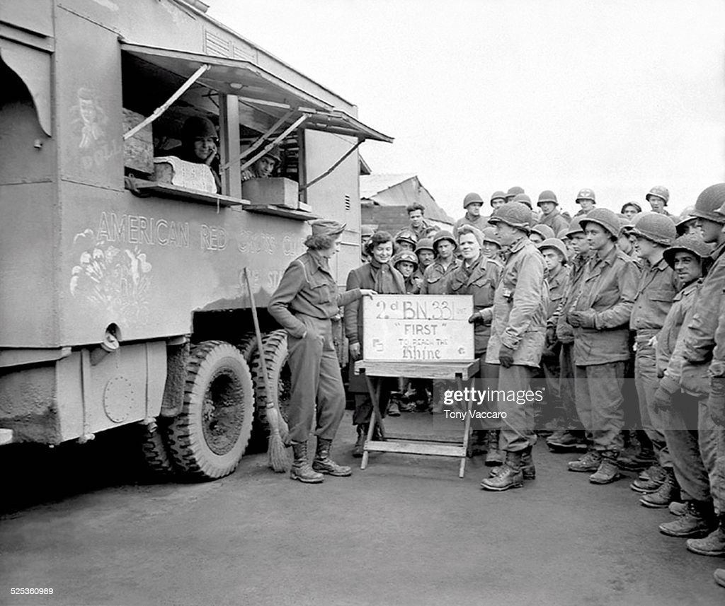 Members of the 331st Regiment 2nd Battalion of the 83rd Infantry Division at the American Red Cross 'Lone Star' Club mobile seen here in Neuss...