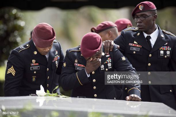 TOPSHOT Members of the 3rd Special Forces Group 2nd battalion cry at the tomb of US Army Sgt La David Johnson at his burial service in the Memorial...