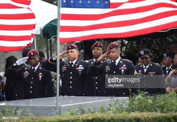 Members of the 3rd Special Forces Group 2nd battalion Fse salute the casket of US Army Sgt La David Johnson at his burial service in the Memorial...