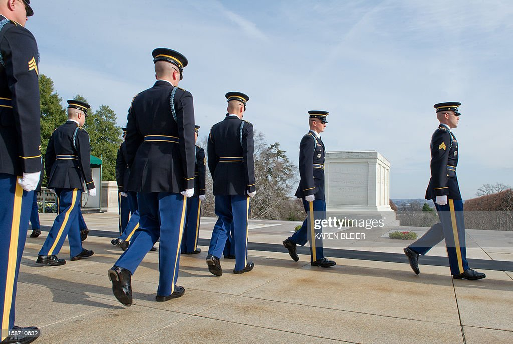 Members of the 3rd United States Infantry Regiment, 'The Old Guard,' Tomb Guards, march into position before placing a wreath at the Tomb of the Unknowns, December 25, 2012 in Arlington National Cemetery in Virginia. AFP PHOTO /Karen BLEIER