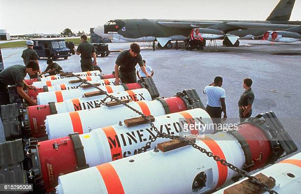 Members of the 43rd Munitions Maintenance Squadron prepare to load Mark 52 training mines onto a 43rd Strategic Wing B52G Stratofortress aircraft...