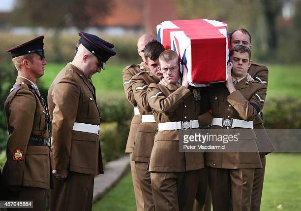 Members of the 4th Battalion The Yorkshire Regiment carry a flag draped coffin containing the remains of a World War One soldier during a reburial...
