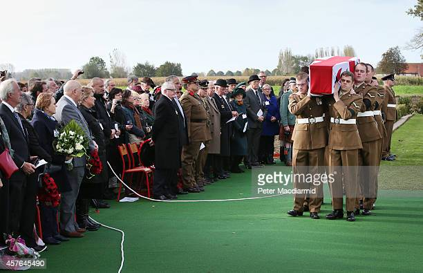 Members of the 4th Battalion The Yorkshire Regiment carry the remains of a World War One soldier during a reburial ceremony at the Commonwealth War...