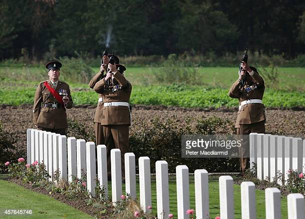 Members of the 4th Battalion The Yorkshire Regiment fire a volley of shots during a reburial ceremony at the Commonwealth War Graves Commission YFarm...