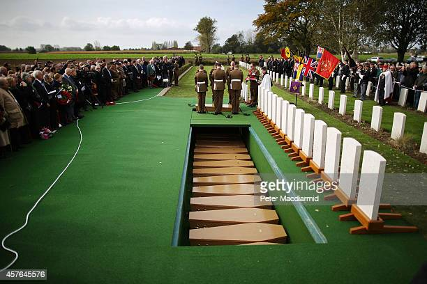 Members of the 4th Battalion The Yorkshire Regiment lower a coffin holding the remains of a World War One soldier during a reburial ceremony at the...